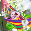 Little girl relaxing in a hammock — Stock Photo #71341963