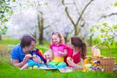 Young family with kids having picnic outdoors — Stock Photo