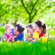 Young family with kids having picnic outdoors — Stock Photo #72417803