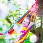 Little girl relaxing in a hammock — Stock Photo #72476389