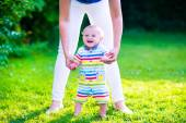 Little baby boy making first steps — Stock Photo