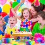 Family celebrating birthday party — Stock Photo #73391129