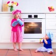 Kids baking in a white kitchen — Stock Photo #73391381