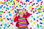 Little girl playing with colorful blocks — Stock Photo
