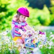 Little girl riding a bike — Stock Photo #73951399