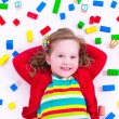 Little girl playing with wooden blocks — Stock Photo #73951479