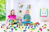 Kids playing at day care with wooden toys — Stock Photo