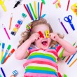 Littel girl with school supplies — Stock Photo #74165059