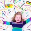 Littel girl with school art supplies — Stock Photo #74164989