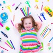 Littel girl with school supplies — Stock Photo #74164991
