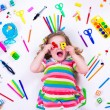 Littel girl with school supplies — Stock Photo #74165023