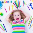 Littel girl with school supplies — Stock Photo #74165027