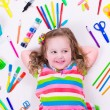 Littel girl with school supplies — Stock Photo #74165029