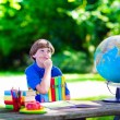 Child studying in school yard. — Stock Photo #74647717