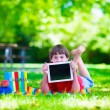 Student child with tablet computer in school yard — ストック写真 #74647759