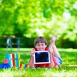 Student child with tablet computer in school yard — ストック写真 #74647817