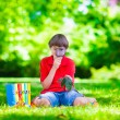 Child in school yard with magnifying glass — Stock Photo #74647883