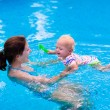 Mother and baby in a swimming pool — Stock Photo #75869741