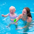 Mother and baby in a swimming pool — Stock Photo #75869863