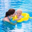Mother and baby in a swimming pool — Stock Photo #75869931
