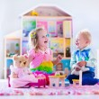 Kids playing with stuffed animals and doll house — Stock Photo #75870173
