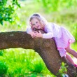 Little girl climbing a tree — Stock Photo #75870177