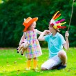 Kids playing in Halloween costumes — Stock Photo #76404061