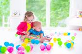 Children playing with colorful toys — Стоковое фото