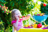 Little girl at garden grill party — Stock Photo