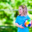 Children playing football outdoors — Stock Photo #76921739