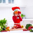 Little girl in chef hat preparing lunch — Stock Photo #76921891