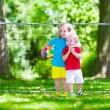 Children playing football outdoors — Stock Photo #77481668