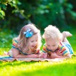 Two kids reading in summer garden — ストック写真 #78964156