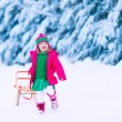 Little girl on a sleigh ride — Stock Photo #80080978