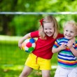 Kids playing football in a park — Stock Photo #80482270