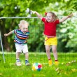 Kids playing football in school yard — Stock Photo #81277046