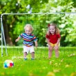 Kids playing football in school yard — Stock Photo #81277048