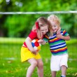 Kids playing football in a park — Stock Photo #81277100