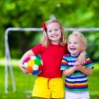 Kids playing football in a park — Stock Photo #81277198