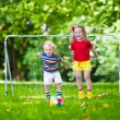 Kids playing football in school yard — Stock Photo #81277206