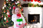 Little girl opening presents on Christmas morning — Stock Photo