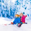 Kids having fun on a sleigh ride in snow — Stock Photo #82276796