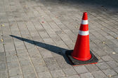 Traffic cone on the sidewalk — Stock Photo
