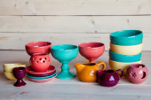 Colorful tableware on a wooden background — Stock Photo