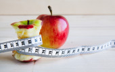 Apple stump and measuring tape — Stock Photo