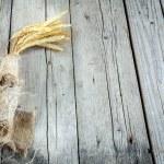 tarwe oren op houten tafel — Stockfoto #55377385