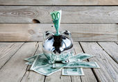 Piggy bank on wooden table on grey background — Stock Photo