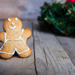 Christmas cookies with festive decoration. Gingerbread cookies hanging over wooden background. Christmas card — Stock Photo #58663653