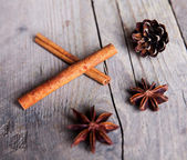Close-up of anise star and cinnamon stick grouped on wooden back — Stock Photo