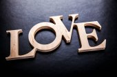 Text love on black background — Stock Photo